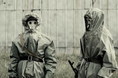 Military mans in protective suit and gas mask outdoors — Stock Photo