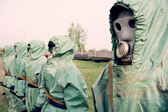 Soldiers in their masks and protective clothing — Stock Photo