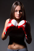 Beautiful girl with the boxing gloves,dark background — Foto de Stock