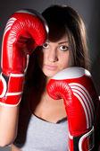 Closeup beautiful girl with the boxing gloves — Foto de Stock