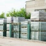 Packed cinder blocks outdoors in racks — Stock Photo #49048849