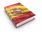 Book covered with Spanish flag — Stock Photo