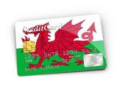 Kreditní karty pokryté vlajka walesu. — Stock fotografie