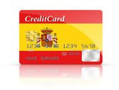 Credit Card covered with Spain flag. — Stock Photo