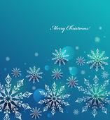 Vektor jul bakgrund med vita snöflingor. — Stockvektor