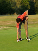 Golfer picking — Stock Photo