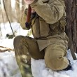 Woman in military uniform in the woods with guns — Stock Photo