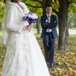 The groom and the bride on walk in autumn park — Stock Photo