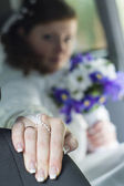 Bride sitting in a car with a wedding ring on his hand — Stock Photo