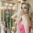 Fashion sensual model posing on carousel — Stock Photo