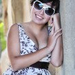 Sexy woman in dress with sunglasses — Stock Photo