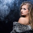 A beautiful blonde woman in fur - Stock fotografie