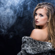 A beautiful blonde woman in fur - Stockfoto
