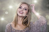 Spotless young blond woman smiles at you — Stock Photo