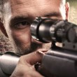 Portrait of serious man aiming with gun - Stockfoto