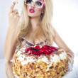Beautiful blonde woman with a cake - Stock Photo
