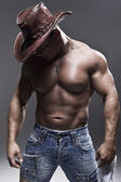 A muscular man in a cowboy hat — Stock Photo