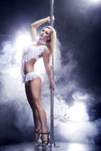 Young sexy pole dance woman. — Stock Photo