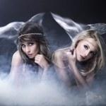 Two women like siren — Stock Photo