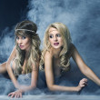 Two women like siren - Stock Photo