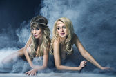 Two women like siren — Stock Photo