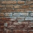 Weathered stained old brick wall background — Stock Photo