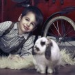 Smiling boy with rabbit — Stock Photo