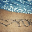 I love you - written in the sand with a foamy wave underneath — Stok fotoğraf