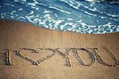 I love you - written in the sand with a foamy wave underneath — Photo