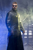 Matrix Style Role Play Character Adult Man in Trench Coat in old factory — Stock Photo