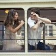Couple with heads out the train window. Love — Stock Photo