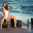 Beauty young woman on the beach — Stock Photo