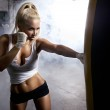 Young woman fitness boxing in front of punching bag — Foto de Stock   #30086015