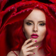 Beautiful Woman with Healthy Red Hair and rose — Stock Photo