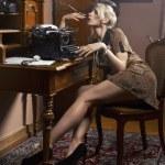 Sexy woman smoking a cigarette — Stock Photo