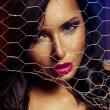 Sexy woman behind wire fence — Stock Photo