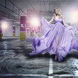 Fantastic fashion woman in fluttering dress — Stock Photo