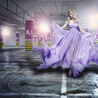 Stock Photo: Fantastic fashion womin fluttering dress