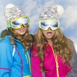 Two beauty smiling women in winter in mountains — ストック写真