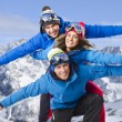Group of cheerful snowboarders friends — Stock Photo