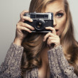 Stock Photo: Smiling woman with camera