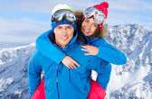 Cute couple wearing snowboard costumes — Stock Photo