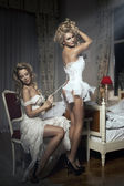 Two girlfriends - A Bride-To-Be and bridesmaid - having fun -Trying On A Wedding Dress — Stok fotoğraf