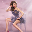 Fashion Dressed Sexy Girl Sitting on Chair. Woman in Purple Dress and High pink Heels — Stock Photo #41933375