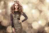 Beauty woman in gold dress — Stock Photo