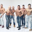 Group of six muscular young sexy wet naked handsome man posing — Stock Photo