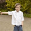 Portrait of cheerful boy showing thumbs up gesture — Stock Photo #45796729
