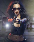 Sexy kobieta z policją jednolite w studio na ciemnym tle czerwony i niebieski — Zdjęcie stockowe