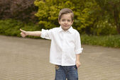 Portrait of cheerful boy showing thumbs up gesture — Stock Photo
