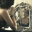 Woman looking at mirror reflection. — Stock Photo #47735909
